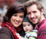Happy Couple with Infant